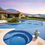 Pool and spa with sunset